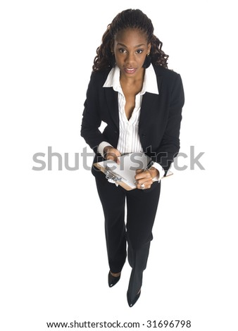 Isolated high angle studio shot of a businesswoman writing on a clipboard.