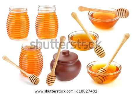Isolated honey. Glass bowl, pot and honey stick isolated on white background with clipping path