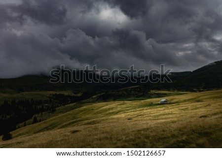 Isolated house in the mountains, moody weather. #1502126657