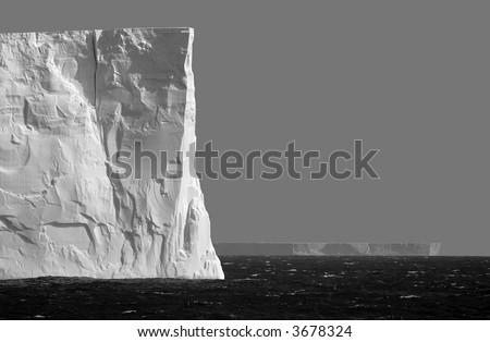 Isolated iceberg in grey
