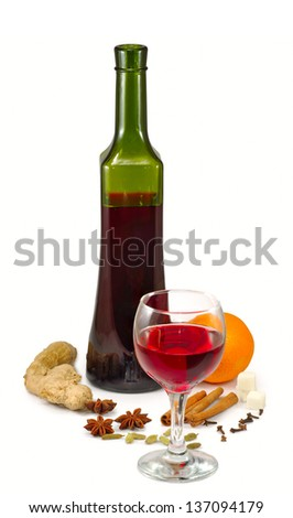 Isolated image of a glass of wine and spices on a white background