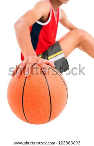 Isolated image of a guy holding a basket ball