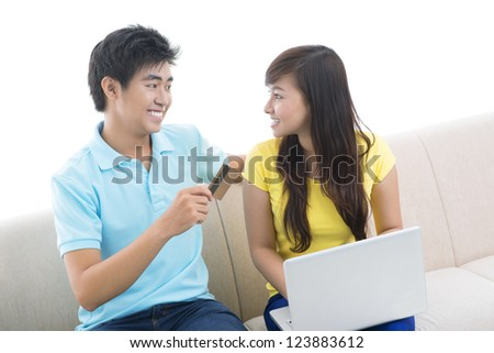 Isolated image of a modern couple being busy with online shopping