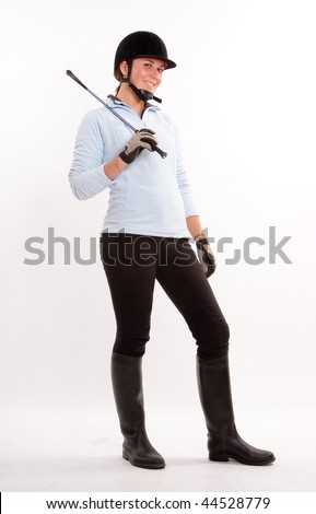 horseback riding outfit. in horse riding clothes