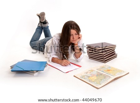 Isolated image of a Young girl studying geography lying on the floor