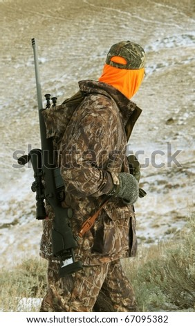 Isolated image of hunter with rifle.  Image taken while hunting big-game in Wyoming.