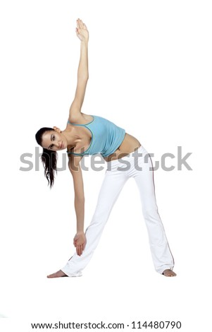 Isolated  image of young woman doing the triangle position in yoga exercise against a white background