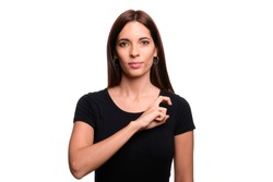 Isolated in white background brunette woman saying black in spanish sign language