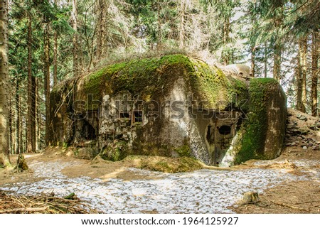 Isolated infantry casemate built in woods and mountainous terrain in Eagle (Orlicke) Mountains, Czech Republic. Czechoslovak pre-war military border fortification system constructed from 1935 to 1938 Photo stock ©