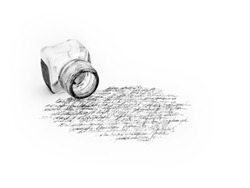 isolated ink pot and hand written calligraphy
