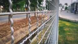 Isolated Iron Wire Mesh Fence on backgroun