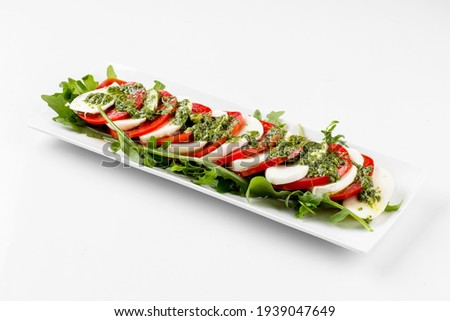 Isolated italian caprese salad with mozzarella and tomatoes on the white background Stok fotoğraf ©