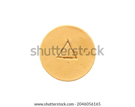 Isolated Korean Dalgona or Ppopgi candy, honeycomb toffee sugar candy with triangle shape on white background