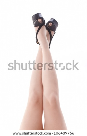 Isolated legs with black shoes on white background