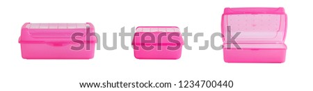 Isolated lunch box. Pink lunch boxes on a white background, in different settings.