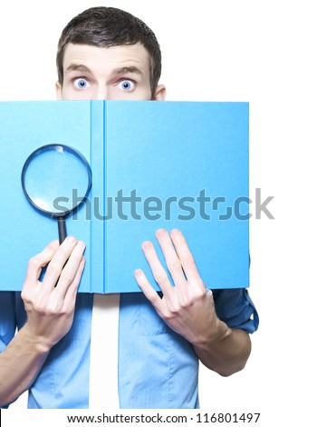Isolated Male Business Person Holding Magnifying Glass And Textbook In A Book Review Concept On White Background