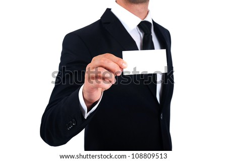 Isolated Man in suit showing business card