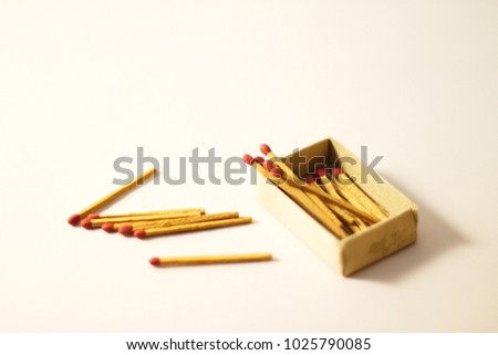 Isolated matchbox and matchsticks #1025790085