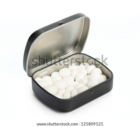 Isolated mint sweets in metal box against the white background