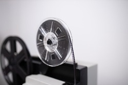 Isolated 8mm projector. Antique video technology. Old retro machine for films. Film strip close up shot