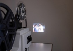 Isolated 8mm projector. Antique video technology. Old retro machine for films. Projection of a negative filmstrip. Cinema concept