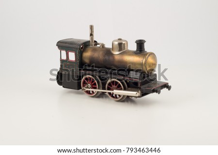 Isolated model of old train locomotive. Antique toy hobby collection. Single isolated locomotive.