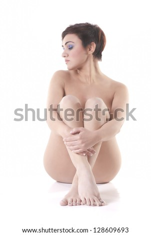 Isolated naked woman sit on white background