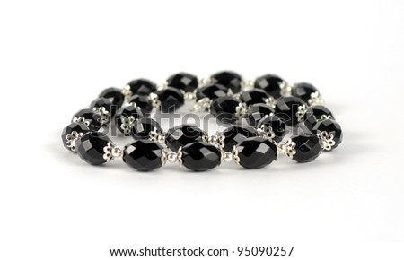 Isolated necklace of black stones