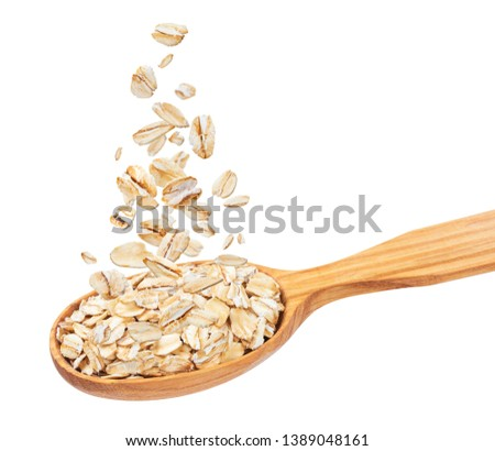 Isolated oatmeal, oat flakes in spoon, flying oat flakes isolated on white background with clipping path, falling oats collection #1389048161