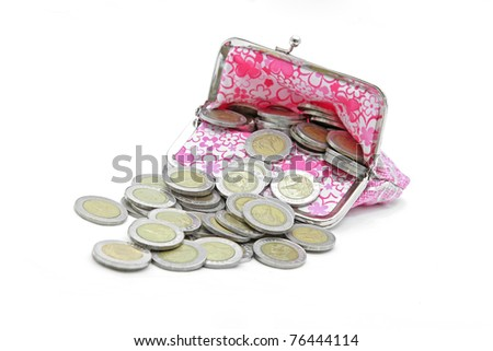 isolated of wealth coins spilling from money bag
