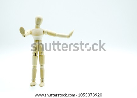 Isolated of wooden figure doll posing with proud gesture on white background