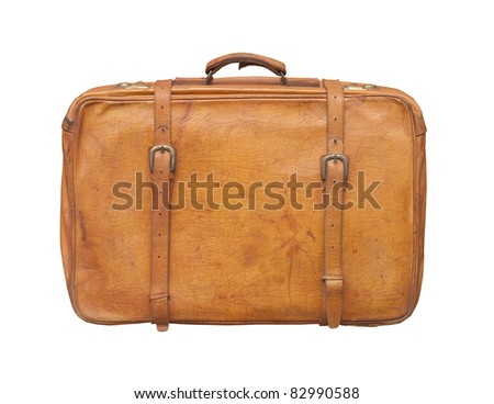 Isolated old and weathered leather suitcase standing