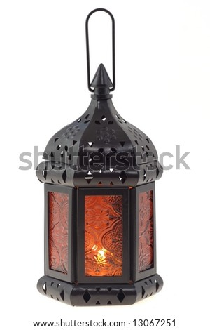 Isolated old-fashioned lamp with candle inside