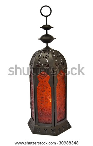 Isolated old lamp with candle inside