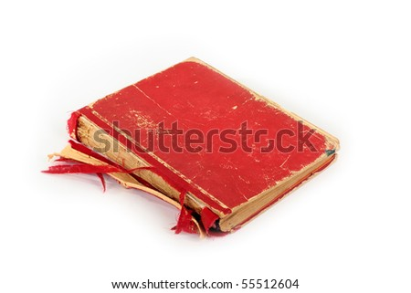 Isolated old torn red book against white background