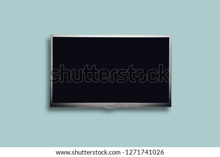 Isolated on a blue pastel background gray TV with a blank screen. Content completion concept, TV with empty screen ready to enter content.