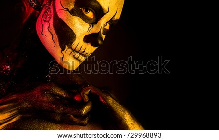 Stock Photo Isolated on black, closeup picture, toned red and yellow, beautiful young blonde caucasian woman with scull body art, grey eyes, look at camera, position at left, languid look
