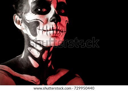 Stock Photo Isolated on black, closeup picture, toned red, attractive young brunette caucasian woman with scull body art, grey eyes, languid look, look at camera