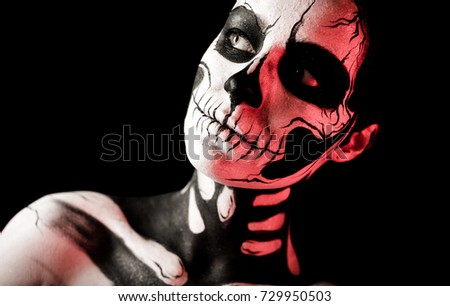 Stock Photo Isolated on black, closeup picture, toned red, attractive young brunette caucasian woman with scull body art, grey eyes, languid look, look at left