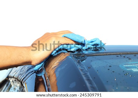 Isolated on white background. cleaning black car by hand