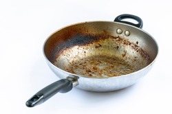 Isolated on white background, Iron frying pan with burning mark, oily stains after cooking. Ingrain burning on iron pan, black handle, big area of oily stains, burnt black blemish.