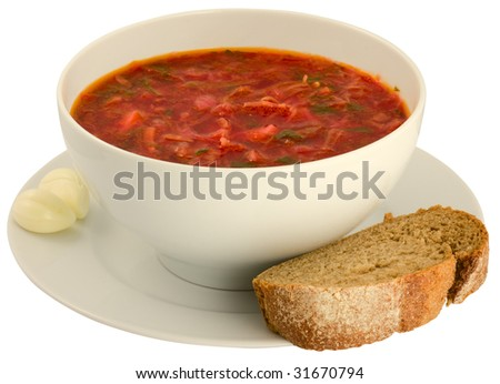 Isolated on white  borscht with slice of bread and garlic (clipping path)