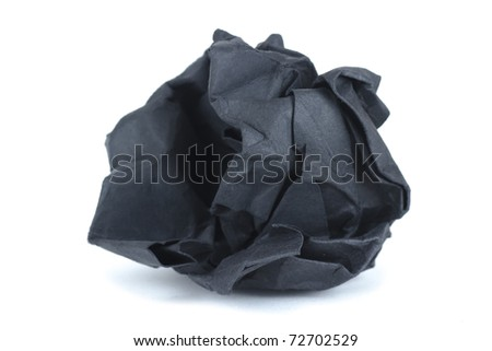 isolated on white crumpled black paper into a ball