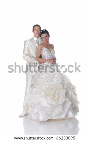 stock photo Isolated on white groom in lightcolored suit and bride in
