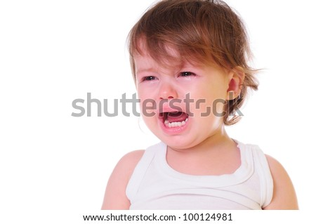 isolated on white. small child is crying hard. Tears stream down his cheeks. photo in high-key