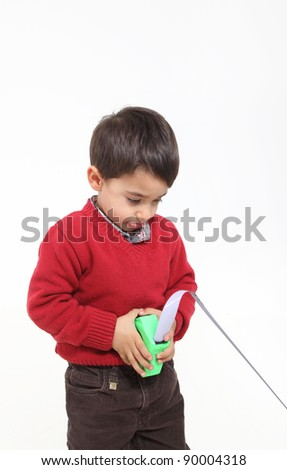 Isolated on white young boy play with meter