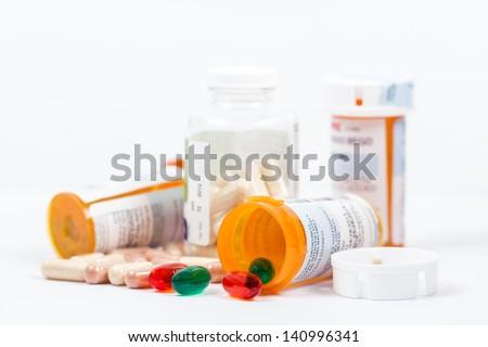 Isolated Orange Prescription Medication Bottles with Pills