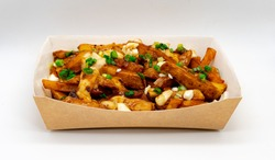Isolated Original Canadian Poutine,  Skin On Fries Topped With Gravy And Cheese Curds In Cardboard Box