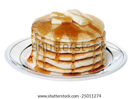 Isolated pancakes with butter and syrup