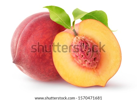 Isolated peach fruits. One whole fresh peach and a half with kernel and leaves isolated on white background with clipping path